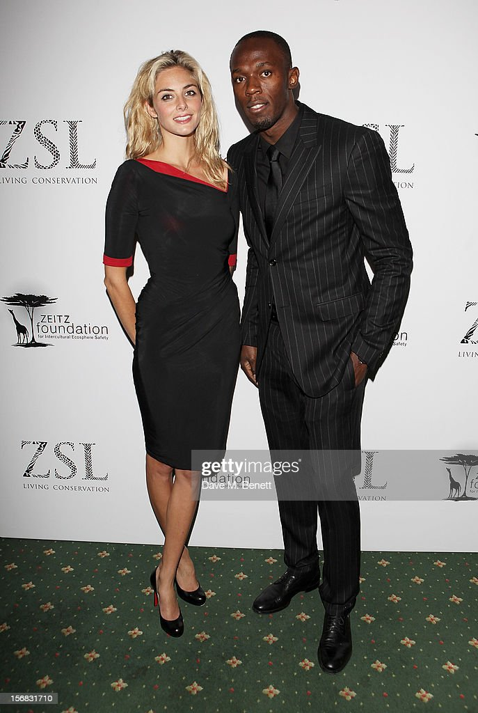 Tamsin Egerton (L) and Usain Bolt arrive at the Zeitz Foundation and ZSL Gala at London Zoo on November 22, 2012 in London, England.
