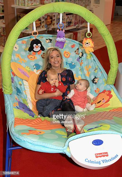Tamsin Outhwaite poses with children at a Fisher Prince photocall during the Baby Show at Earls Court on October 22 2010 in London England