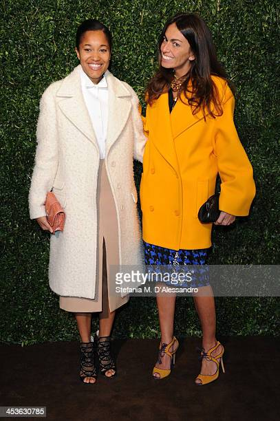 Tamu McPherson and Viviana Volpicella attends Michael Kors To celebrate Milano opening on December 4 2013 in Milan Italy