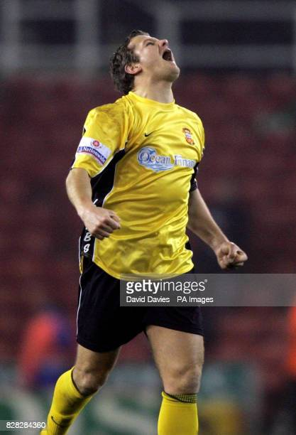 Tamworth playercoach Mark Cooper celebrates their 00 draw against Stoke City in the FA Cup Third Round match at the Britannia Stadium Stoke Saturday...