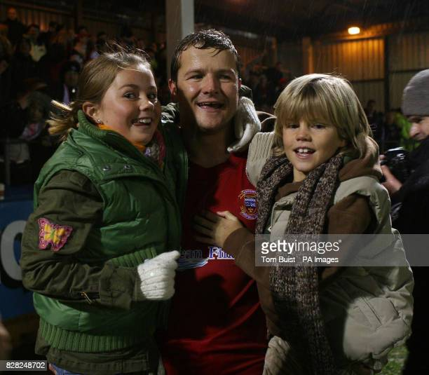 Tamworth's Mark Cooper celebrates with his son Charlie and daughter Demi following their 21 victory over Hartlepool in the FA Challenge Cup second...