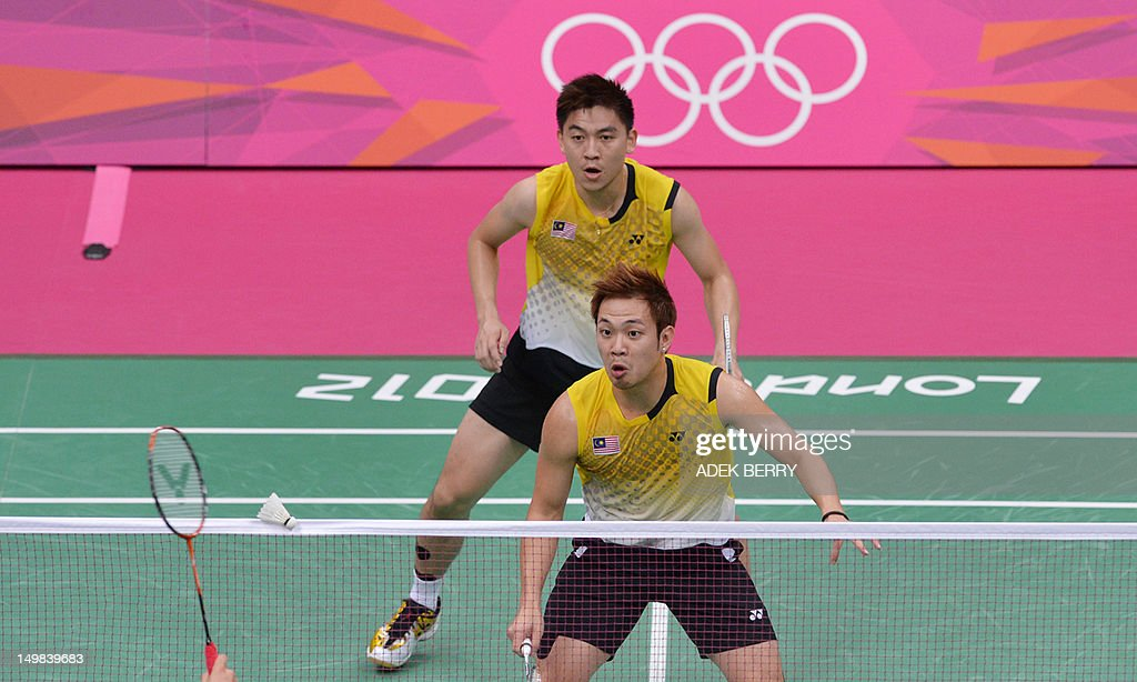 Tan Boon Heong (front) of Malaysia and Koo Kien Keat (back) eye the shuttle cock during the bronze medal men's doubles badminton match against South Korea's Lee Yong Dae and Chung Jae Sung at The London 2012 Olympic Games in London on August 5, 2012. South Korea won the match 23-12, 21-10.