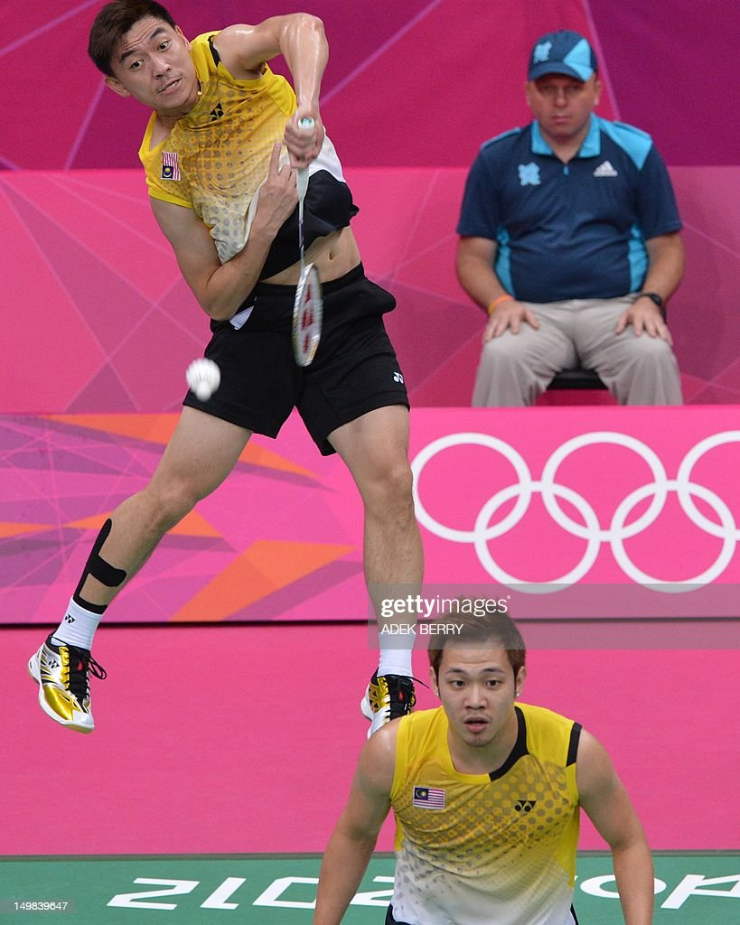 Tan Boon Heong (top) of Malaysia play a shot with Koo Kien Keat (bottom) during the bronze medal men's doubles badminton match against South Korea's Lee Yong Dae and Chung Jae Sung at The London 2012 Olympic Games in London on August 5, 2012. South Korea won the match 23-12, 21-10.