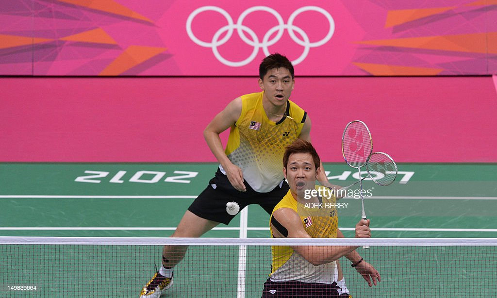 Tan Boon Heong (front) of Malaysia play a shot with Koo Kien Keat (back) during the bronze medal men's doubles badminton match against South Korea's Lee Yong Dae and Chung Jae Sung at The London 2012 Olympic Games in London on August 5, 2012. South Korean won the match 23-12, 21-10.