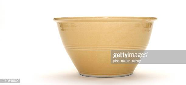 Tan ceramic bowl isolated on white background