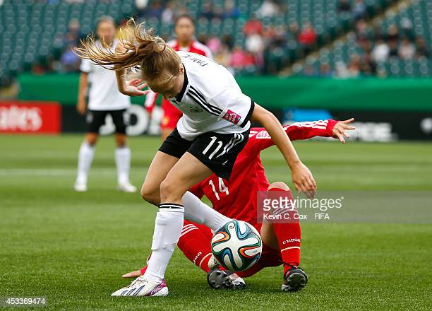 Tan Ruyin of China PR challenges Theresa Panfil of Germany at Commonwealth Stadium on August 8 2014 in Edmonton Canada