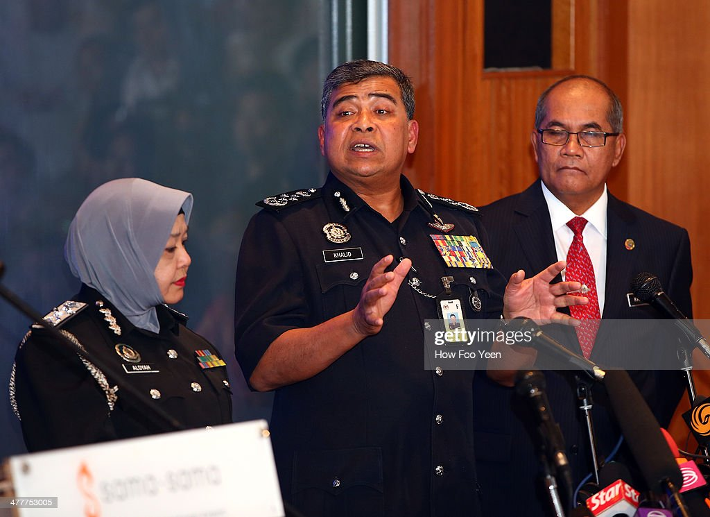 Tan Sri Khalid Abu Bakar, Inspector General Police of Malaysia (centre) briefs the media on the progress of their investigations on March 11, 2014 in Kuala Lumpur, Malaysia. Officials have expanded the searh area for missing Malaysia Airlines flight MH370 to include more of the Gulf of Thailand between Malayisa and Vietnam and land along the Malay Pensinusula. The flight carrying 239 passengers from Kuala Lumpur to Thailand was reported missing on the morning of March 8 after the crew failed to check in as scheduled. Relatives of the missing passengers have been advised to prepare for the worst as authorities focus on two passengers on board travelling with stolen passports.
