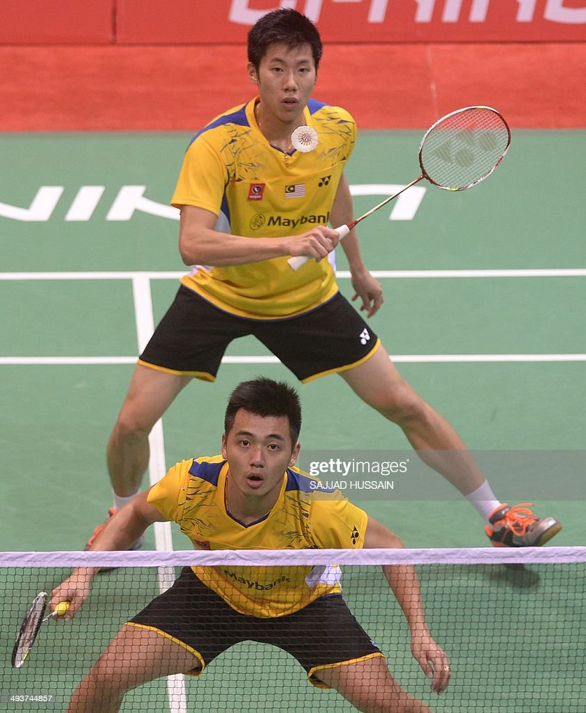 Tan Wee Kiong front and Goh V Shem of Malaysia in action against