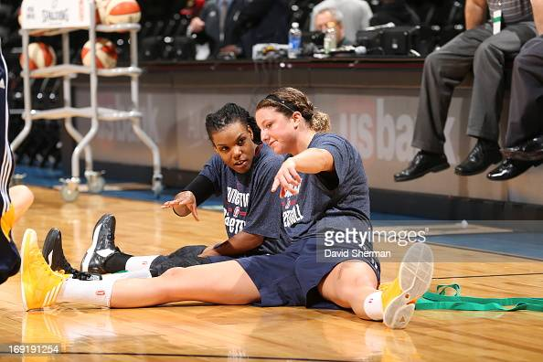 Tan White and Kelsey Griffin of the Connecticut Sun discuss strategy during warm ups before the WNBA preseason game against the Minnesota Lynx on May...