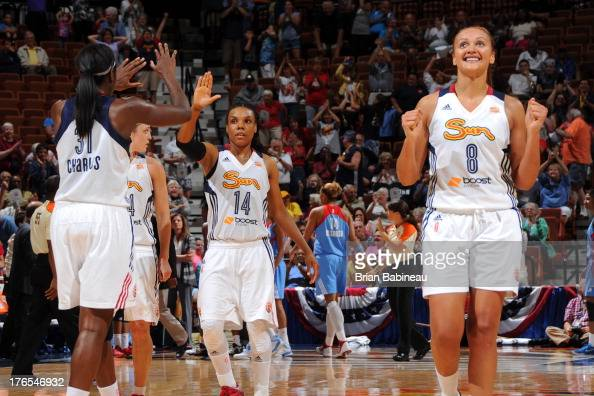 Tan White of the Connecticut Sun celebrates with her teammates after hitting the game winning shot against the Atlanta Dream on August 14 2013 at the...