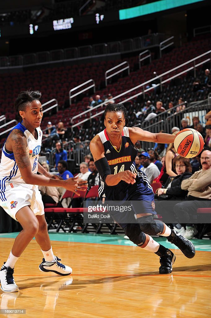 Tan White of the Connecticut Sun drives the basketball against Shenneika Smith of the New York Liberty during the WNBA game on May 18 2013 at the...