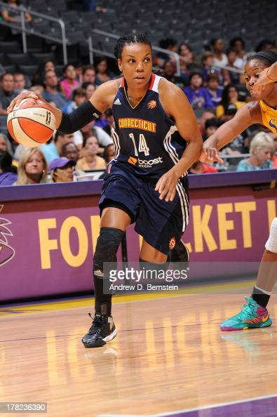 Tan White of the Connecticut Sun drives to the basket during a game against the Los Angeles Sparks at STAPLES Center on August 27 2013 in Los Angeles...