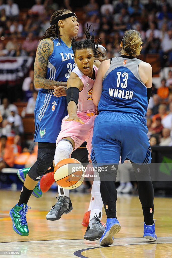 Tan White of the Connecticut Sun gets fouled by Lindsay Whalen of the Minnesota Lynx on August 22 2013 at the Mohegan Sun in Uncasville Connecticut...