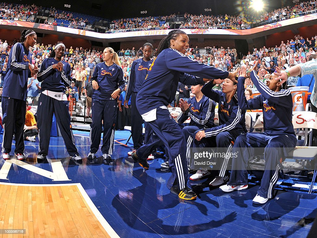 Tan White of the Connecticut Sun high fives her teammates before the WNBA game against the Washington Mystics on May 23 2010 at the Mohegan Sun Arena...