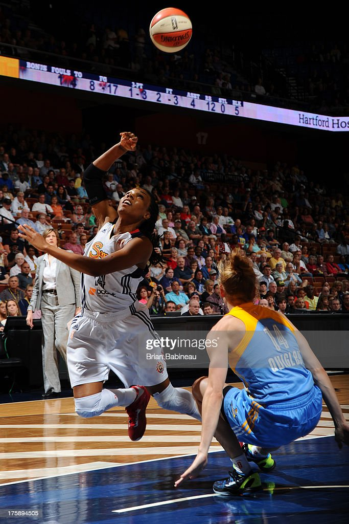 Tan White of the Connecticut Sun shoots against Allie Quigley of the Chicago Sky on August 9 2013 at the Mohegan Sun in Uncasville Connecticut NOTE...