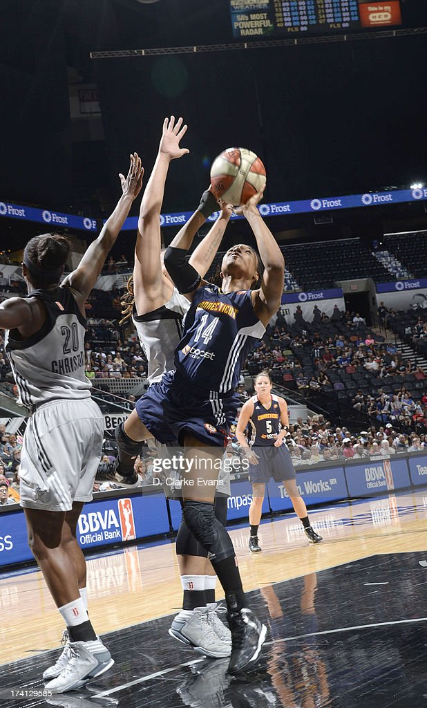 Tan White of the Connecticut Sun shoots against Shameka Christon of the San Antonio Silver Stars at the ATT Center on July 20 2013 in San Antonio...