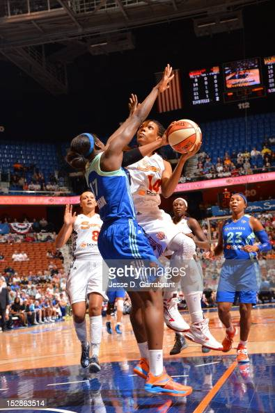 Tan White of the Connecticut Sun shoots against the New York Liberty during game one of the 2012 WNBA Playoffs on September 27 2012 at the Mohegan...
