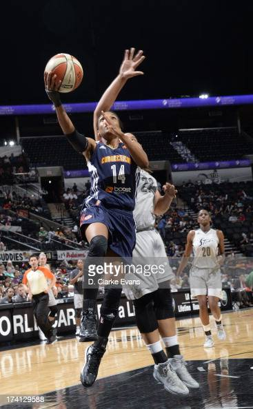 Tan White of the Connecticut Sun shoots against the San Antonio Silver Stars at the ATT Center on July 20 2013 in San Antonio Texas NOTE TO USER User...