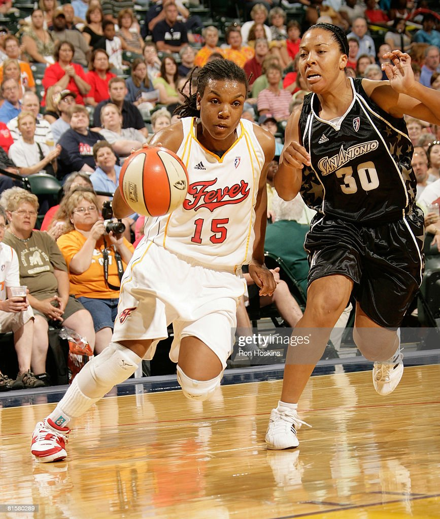 Tan White of the Indiana Fever drives on Helen Darling of the San Antonio Silver Stars at Conseco Fieldhouse on June 15 2008 in Indianapolis Indiana...