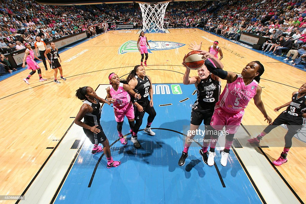 <a gi-track='captionPersonalityLinkClicked' href=/galleries/search?phrase=Tan+White&family=editorial&specificpeople=110087 ng-click='$event.stopPropagation()'>Tan White</a> #5 of the Minnesota Lynx and Jayne Appel #32 of the San Antonio Stars go for the rebound during the WNBA game on July 25, 2014 at Target Center in Minneapolis, Minnesota.