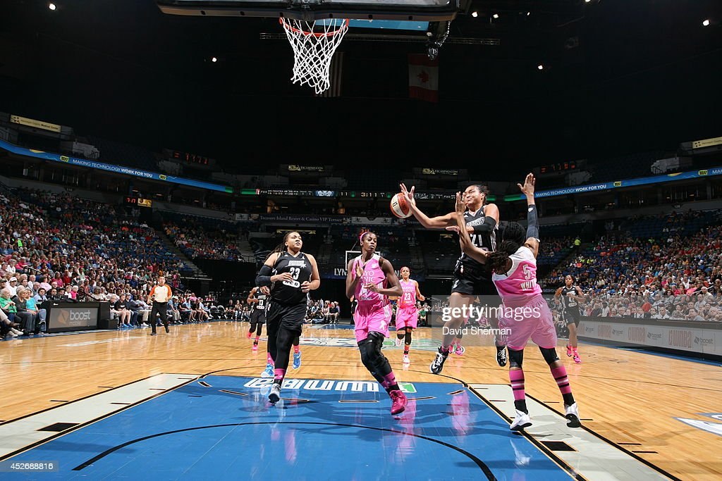 <a gi-track='captionPersonalityLinkClicked' href=/galleries/search?phrase=Tan+White&family=editorial&specificpeople=110087 ng-click='$event.stopPropagation()'>Tan White</a> #5 of the Minnesota Lynx blocks Kayla McBride #21 of the San Antonio Stars as she goes for the shot during the WNBA game on July 25, 2014 at Target Center in Minneapolis, Minnesota.