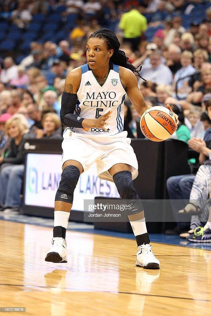 Tan White of the Minnesota Lynx dribbles the ball against the Indiana Fever during the WNBA game on June 22 2014 at Target Center in Minneapolis...