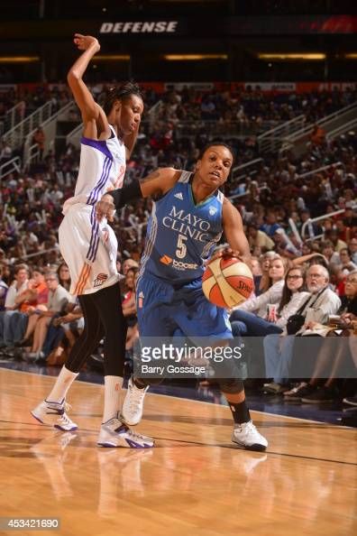 Tan White of the Minnesota Lynx drives against DeWanna Bonner of the Phoenix Mercury on August 9 2014 at US Airways Center in Phoenix Arizona NOTE TO...