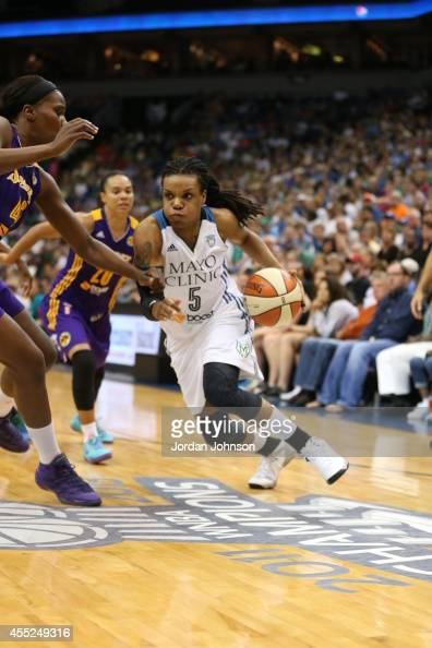 Tan White of the Minnesota Lynx drives against the Los Angeles Sparks during the WNBA game on August 12 2014 at Target Center in Minneapolis...