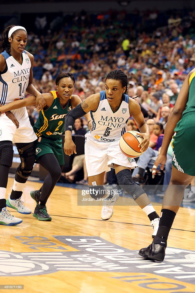 Tan White of the Minnesota Lynx drives against the Seattle Storm on June 29 2014 at Target Center in Minneapolis Minnesota NOTE TO USER User...