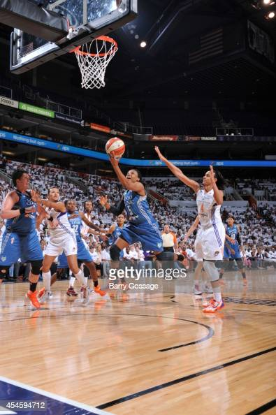 Tan White of the Minnesota Lynx drives to the basket against the Phoenix Mercury in Game 1 of the 2014 WNBA Western Conference Finals on August 29...