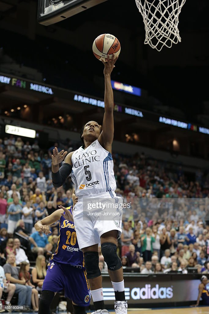 Tan White of the Minnesota Lynx drives to the basket against the Los Angeles Sparks during the WNBA game on July 8 2014 at Target Center in...