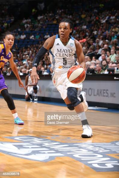 Tan White of the Minnesota Lynx drives to the basket against the Los Angeles Sparks during the WNBA game on August 12 2014 at Target Center in...
