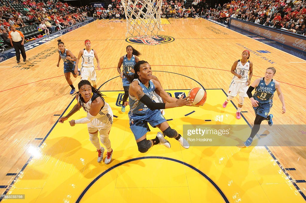 Tan White of the Minnesota Lynx drives to the basket against the Indiana Fever during the WNBA game on August 5 2014 at Bankers Life Fieldhouse in...