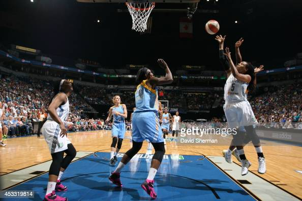 Tan White of the Minnesota Lynx goes for the shot against Sylvia Fowles of the Chicago Sky during the WNBA game on August 7 2014 at Target Center in...
