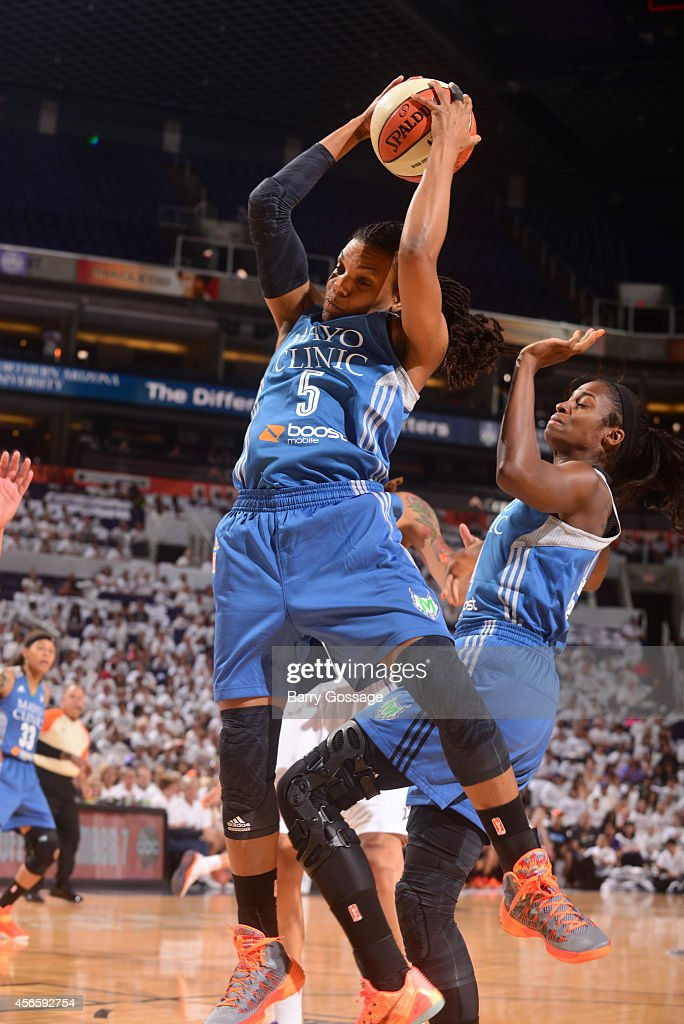 Tan White #5 of the Minnesota Lynx grabs a rebound against the Phoenix Mercury in Game 1 of the 2014 WNBA Western Conference Finals on August 29, 2014 at US Airways Center in Phoenix, Arizona.