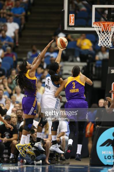 Tan White of the Minnesota Lynx handles the ball against Candace Parker of the Los Angeles Sparks during the WNBA game on August 12 2014 at Target...