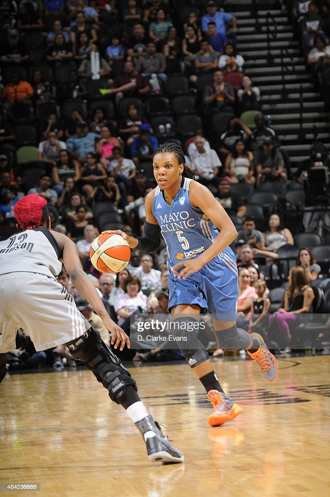 Tan White of the Minnesota Lynx handles the ball against Danielle Robinson of the San Antonio Stars in Game Two of the Western Conference Semifinals...