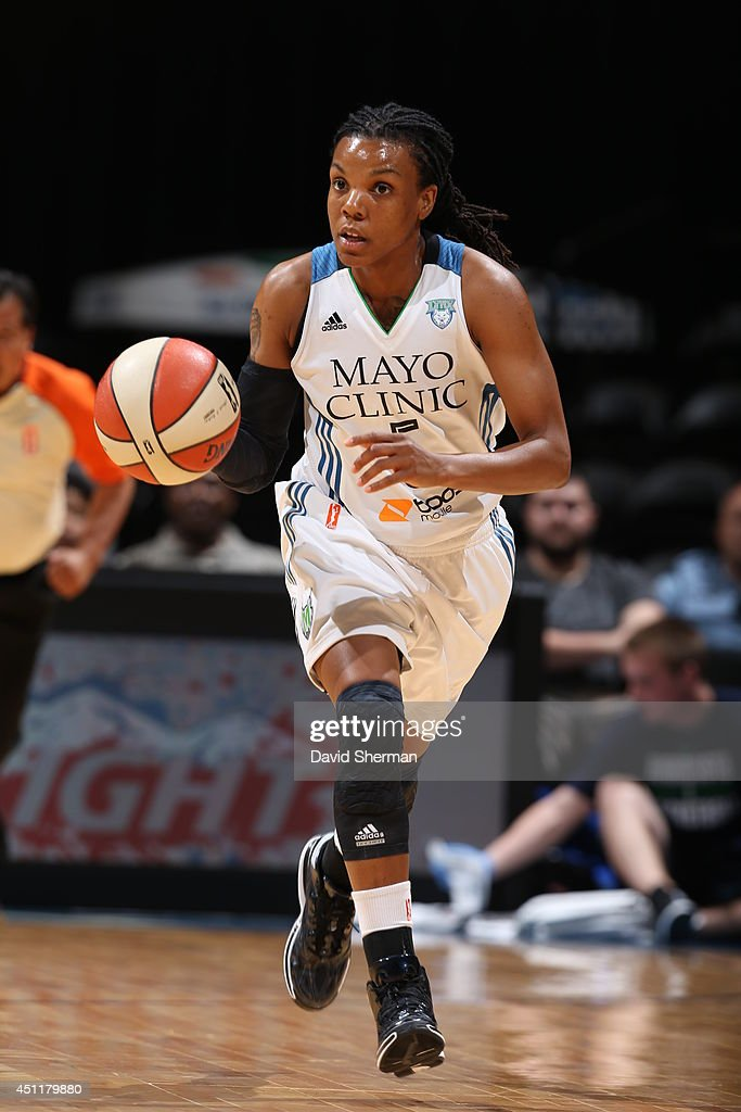 Tan White of the Minnesota Lynx handles the ball against the New York Liberty on May 24 2014 at Target Center in Minneapolis Minnesota NOTE TO USER...