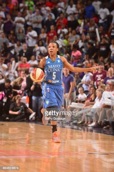 Tan White of the Minnesota Lynx handles the ball against the Phoenix Mercury in Game 3 of the 2014 WNBA Western Conference Finals on September 2 2014...