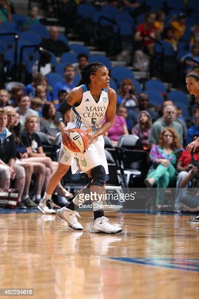 Tan White of the Minnesota Lynx looks to pass the ball against the Tulsa Shock during the WNBA game on July 16 2014 at Target Center in Minneapolis...