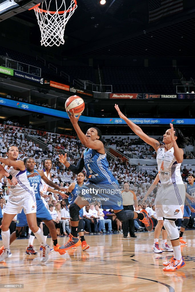 Tan White #5 of the Minnesota Lynx shoots against the Phoenix Mercury in Game 1 of the 2014 WNBA Western Conference Finals on August 29, 2014 at US Airways Center in Phoenix, Arizona.