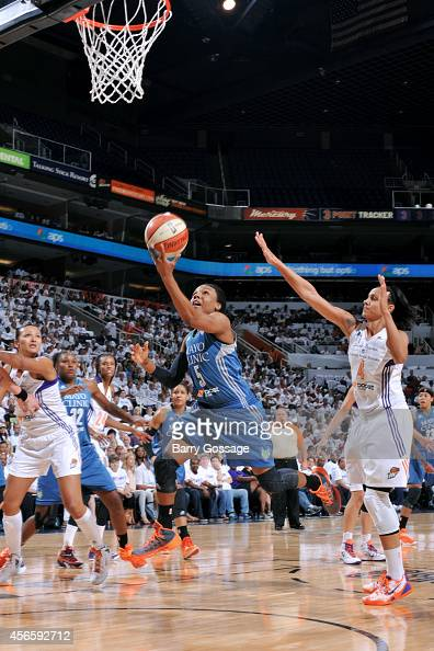Tan White of the Minnesota Lynx shoots against the Phoenix Mercury in Game 1 of the 2014 WNBA Western Conference Finals on August 29 2014 at US...