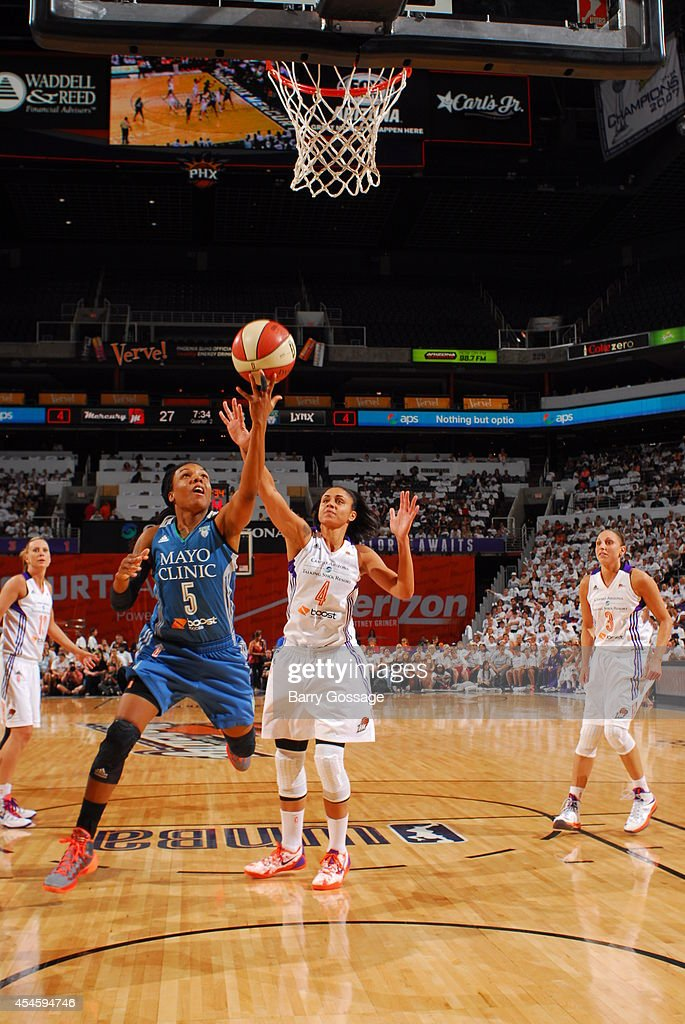 Tan White of the Minnesota Lynx shoots the ball against Candice Dupree of the Phoenix Mercury in Game 1 of the 2014 WNBA Western Conference Finals on...