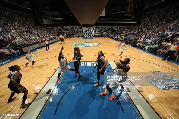 Tan White of the Minnesota Lynx shoots the ball against Jia Perkins of the San Antonio Stars in Game One of the Western Conference Semifinals during...