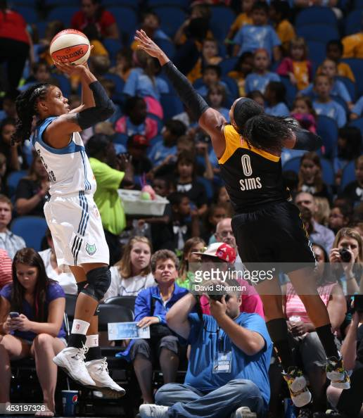 Tan White of the Minnesota Lynx shoots the ball against Odyssey Sims of the Tulsa Shock during the WNBA game on July 16 2014 at Target Center in...