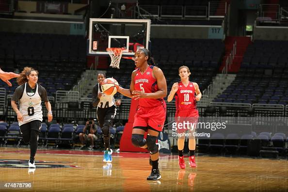 Tan White of the Washington Mystics drives against the Minnesota Lynx during an Analytic Scrimmage at the Verizon Center on May 26 2015 in Washington...