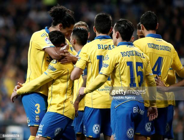 Tana of Las Palmas celebrates the goal with Mauricio Lemos during the La Liga match between Real Madrid and Las Palmas at Estadio Santiago Bernabeu...