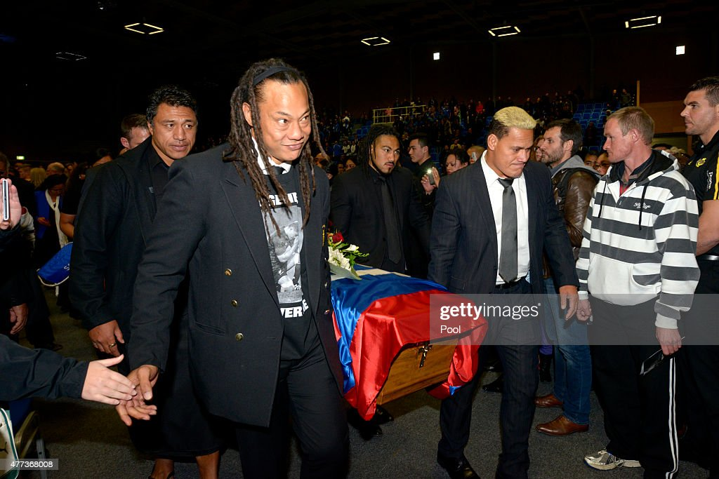 Tana Umaga (2nd L) and...