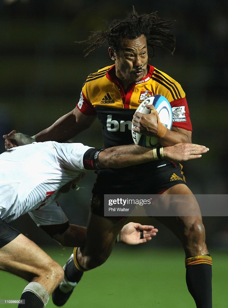 <a gi-track='captionPersonalityLinkClicked' href=/galleries/search?phrase=Tana+Umaga&family=editorial&specificpeople=203218 ng-click='$event.stopPropagation()'>Tana Umaga</a> of the Chiefs is tackled during the round five Super Rugby match between the Chiefs and the Sharks at Waikato Stadium on March 18, 2011 in Hamilton, New Zealand.
