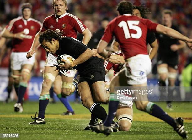 Tana Umaga the All Black captain dives over to score a try during the third test match between The New Zealand All Blacks and the British and Irish...